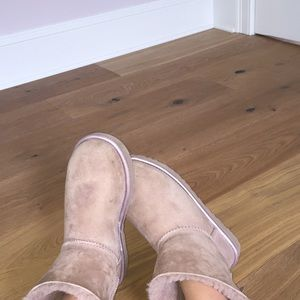 a cute pair of light pink uggs